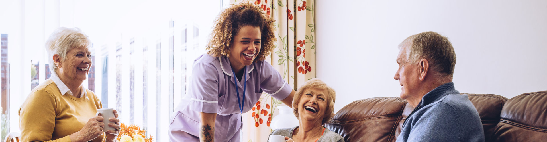 happy caregiver and elderlies
