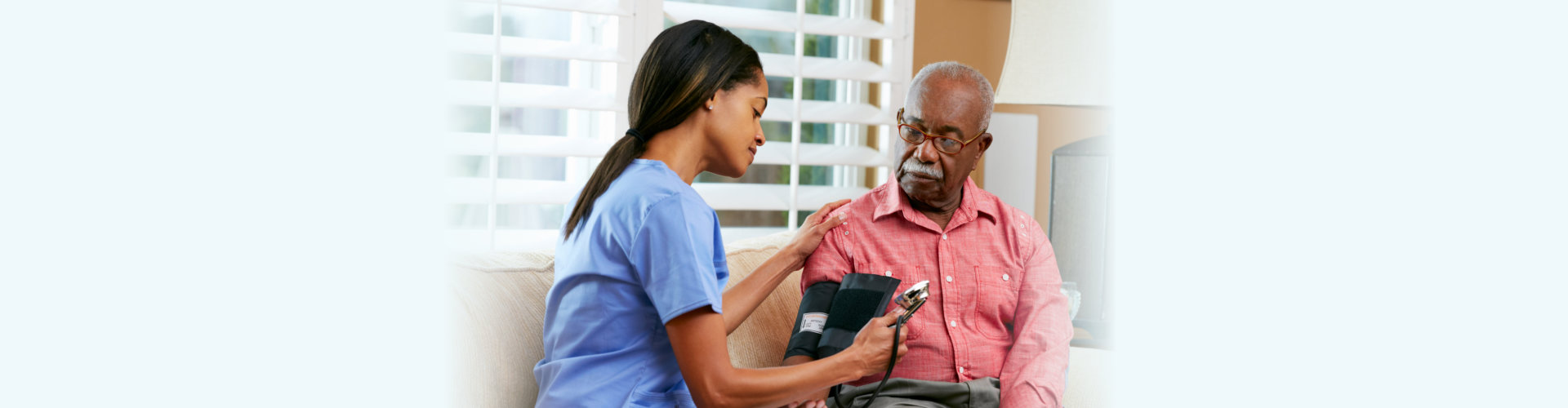Nurse Visiting Senior Male Patient At Home Taking Notes